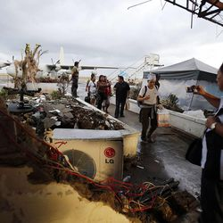Airline passengers arrive at the typhoon damaged airport in Tacloban, Thursday, Nov. 21, 2013.