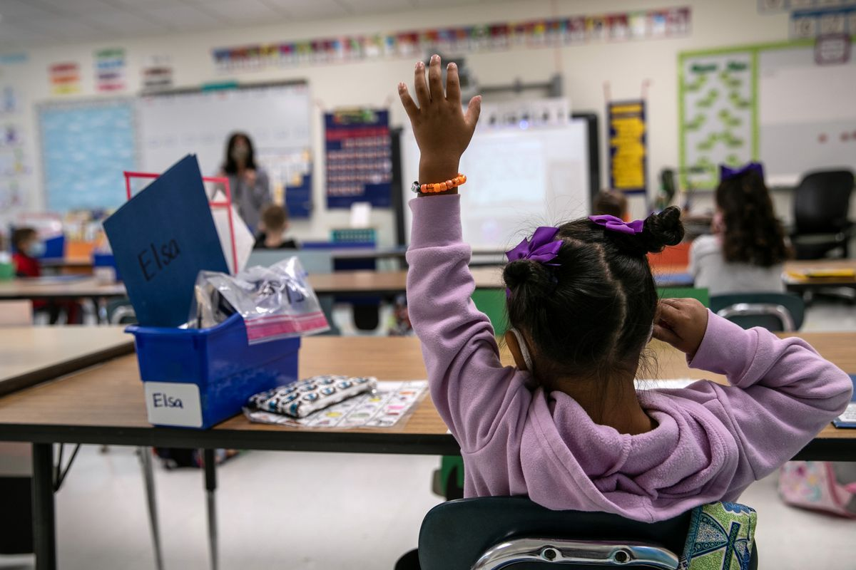 A first-grader attends class at a Connecticut elementary school in mid-September as part of a hybrid schedule.