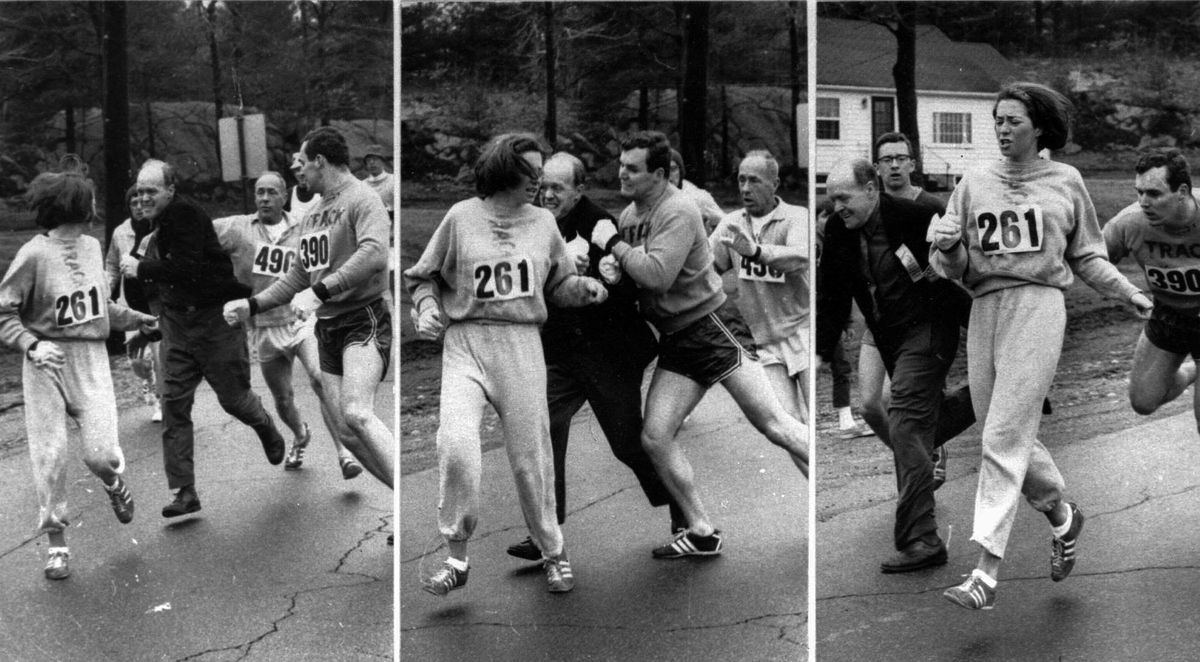 Syracuse University student Kathrine Switzer (261) is shown being chased by a jacketed race official during the running of the Boston Marathon on April 19, 1967.   Associated Press file photo