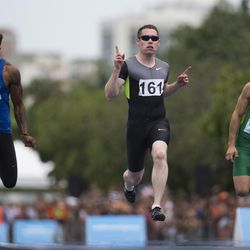 Ireland's Paralympian Jason Smyth, center, celebrates his victory ahead of United States' Richard Browne, left, and Brazil's Petrucio Ferreira, during an event celebrating one year for the start of the Rio 2016 Paralympic Games in Rio de Janeiro, Brazil, Monday, Sept. 7, 2015.