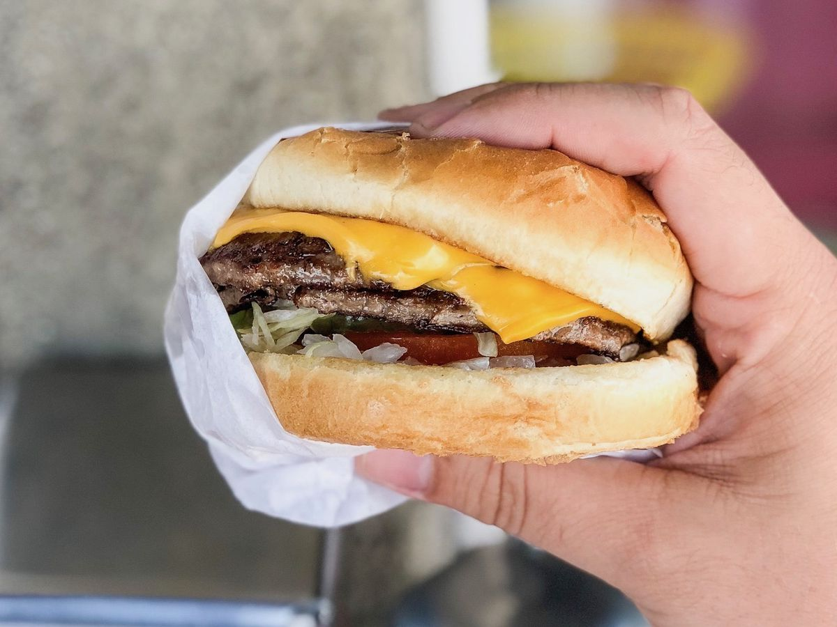 A handheld burger with lots of cheese from Bill's Burgers in the San Fernando Valley.