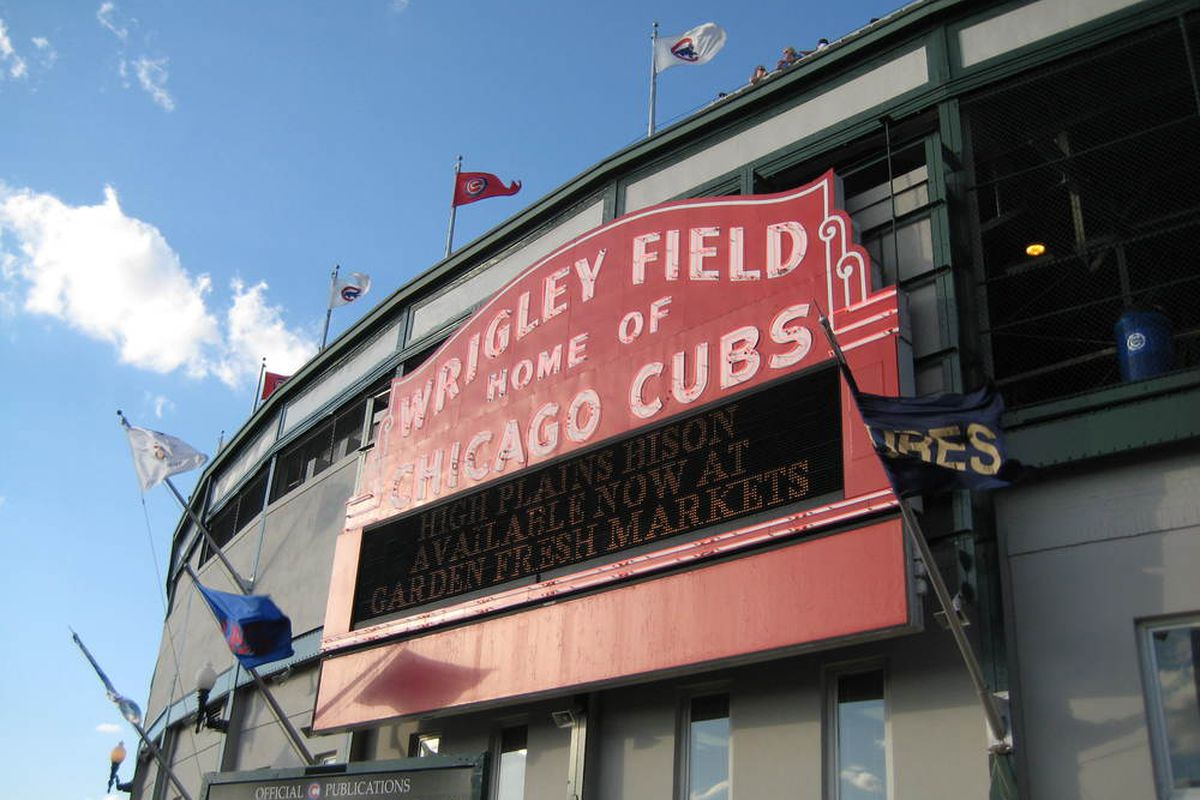 A Padres pennant waving beneath the famous Wrigley Field sign. Larry and Balki not pictured.