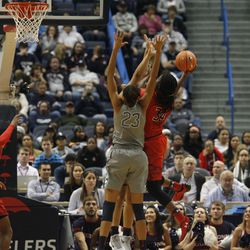 UConn�s Azura Stevens (23) and Gabby Williams try to block the shot of Maryland Terrapins forward Brianna Fraser (34).