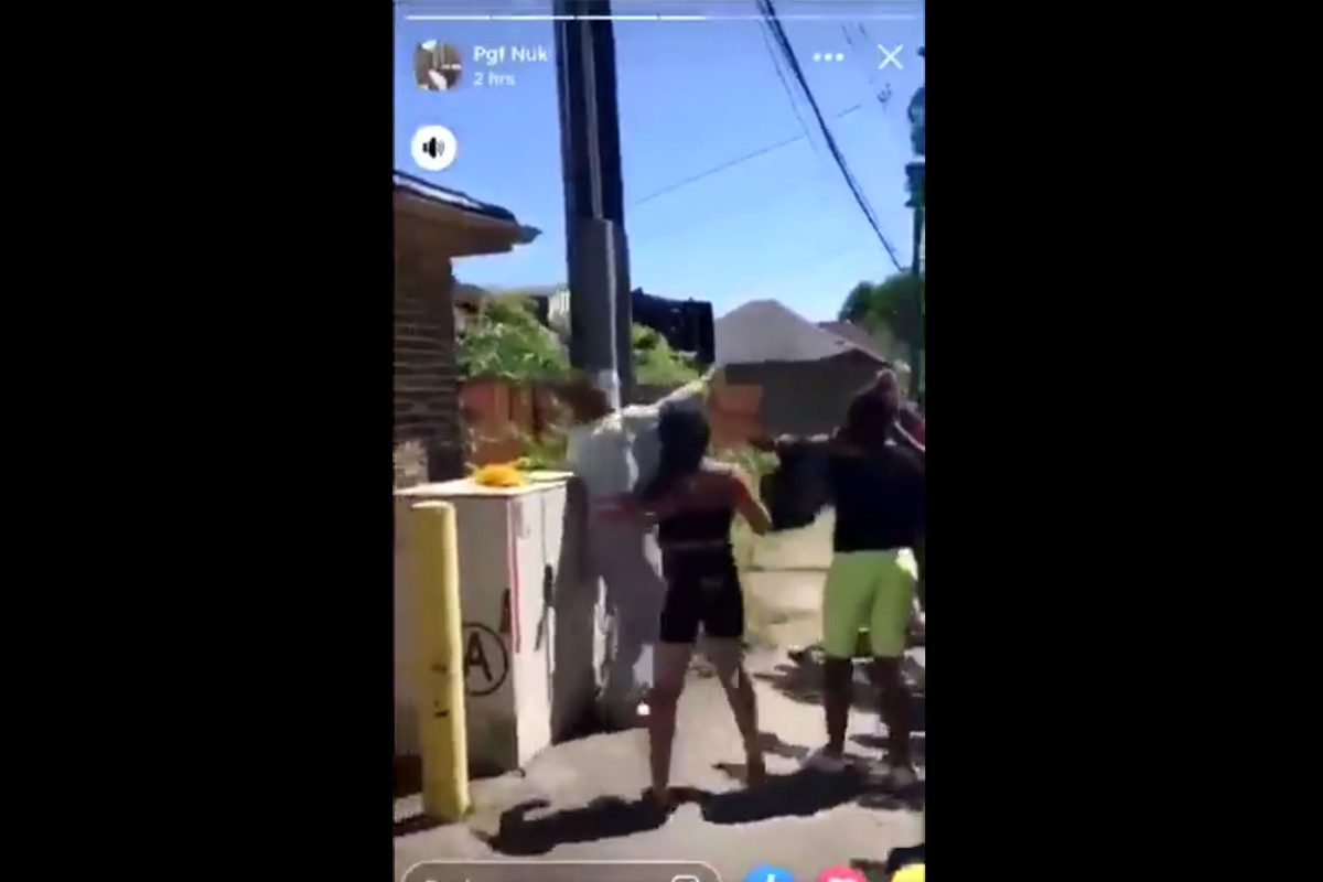 A screengrab from a viral video of a girl being beaten by a group of females.