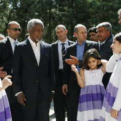 """U.N.-Arab League envoy Kofi Annan, third from left, is welcomed by Syrian refugee children upon his arrival at Yayladagi refugee camp in Hatay province, Turkey, Tuesday, April 10, 2012. Turkey's prime minister Recep Tayyip Erdogan accused Syria of infringing on its border and said Tuesday that his country is considering what steps to take in response, including measures """"we don't want to think about."""""""