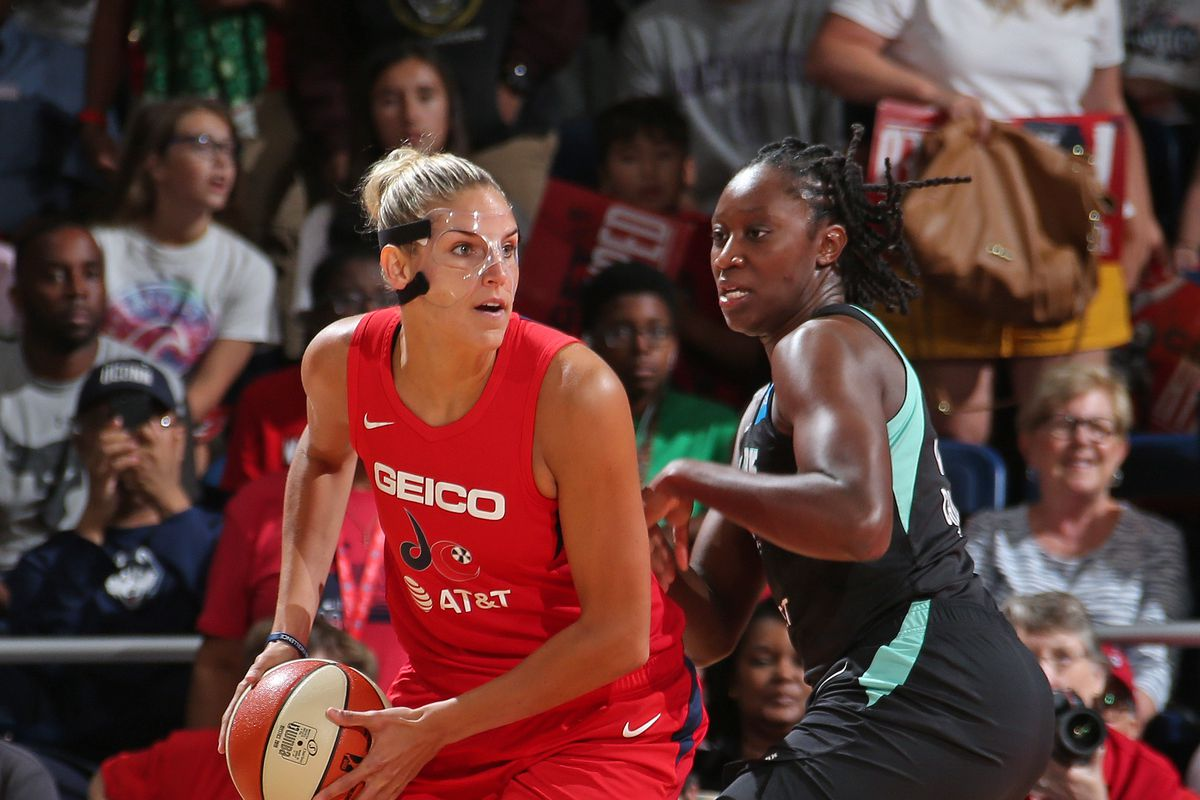 Elena Delle Donne of the Washington Mystics looks to pass the ball during the game against Tina Charles of the New York Liberty on August 25, 2019 at the St. Elizabeths East Entertainment and Sports Arena in Washington, DC.