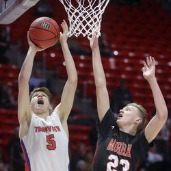 Timpview's Jacob Gates shoots as Murray's Bowen Davies guards him during the 5A boys basketball quarterfinals at the Huntsman Center in Salt Lake City on Tuesday, Feb. 25, 2020. Timpview won 53-32.
