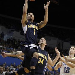 California 's Justin Cobbs, top, goes up for a basket as his teammate Robert Thurman and UCLA's David Wear, bottom left, look on during the first half of an NCAA college basketball game in Los Angeles, Saturday, Feb. 11, 2012.
