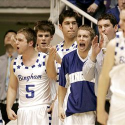 Bingham players celebrate after scoring a basket in Bingham's 56-38 win over Clearfield.