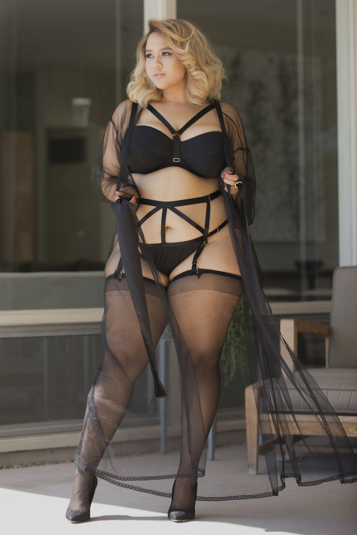 Model Gabi Fresh in black lingerie and a robe