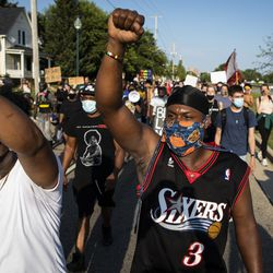 Protesters march on 63rd Street near 20th Avenue in Kenosha on the 5th night of unrest after police shot Jacob Blake, Thursday night, Aug. 27, 2020.
