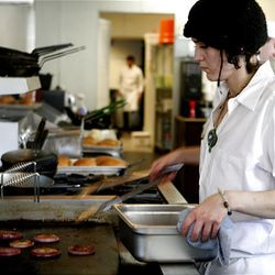 Heather Letz cooks red onions at the Copper Onion restaurant in Salt Lake City.
