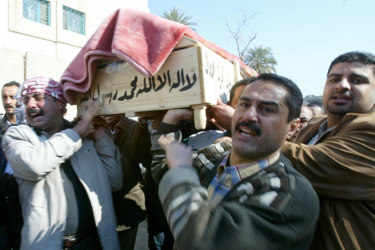 Iraqi mourners carry the coffin of Abdel Razzak al-Naas during his funeral in Baghdad 29 January 2006. Naas, a prominent Iraqi academic and political analyst, was shot dead by gunmen in the Iraqi capital the previous day.