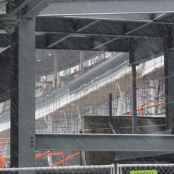 A peek at the left field upper deck, looking through the girders along Waveland Avenue