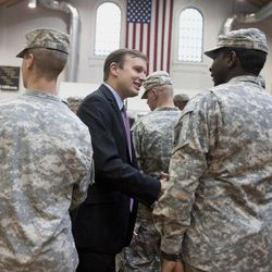 In this Tuesday, Sept. 18, 2012 photo, Democratic candidate for U.S. Senate Chris Murphy, center shakes hands with members of the 1048th Army National Guard Transportation Co. during a send-off ceremony in Hartford, Conn. Wealthy former pro wrestling executive Linda McMahon is shifting her image from groin-kicking CEO to grandmother in her second bid for a Senate seat from Connecticut. Polls show the strategy seems to be working against three-term Democratic congressman Murphy.