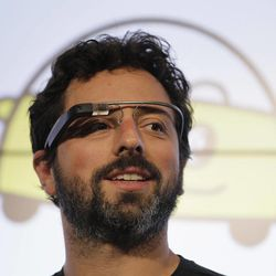 Google co-founder Sergey Brin stands on stage during a bill signing by California Gov. Edmund G. Brown Jr., for driverless cars at Google headquarters in Mountain View, Calif., Tuesday, Sept. 25, 2012.  The legislation will open the way for driverless cars in the state. Google, which has been developing autonomous car technology and lobbying for the legislation has a fleet of driverless cars that has logged more than 300,000 miles (482,780 kilometers) of self-driving on California roads. Brin is wearing internet glasses.