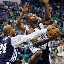 Richard Jefferson reaches in as Mike Harris tries to shoot during the Utah Jazz's scrimmage in Salt Lake City on Saturday, Oct. 5, 2013. In the background is Brian Cook.