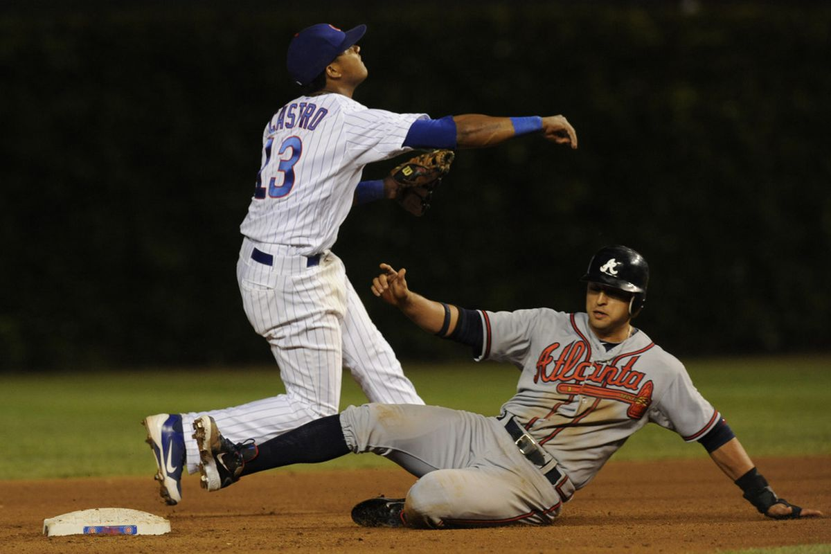 Starlin Castro of the Chicago Cubs forces out Martin Prado of the Atlanta Braves at Wrigley Field in Chicago, Illinois.  (Photo by David Banks/Getty Images)
