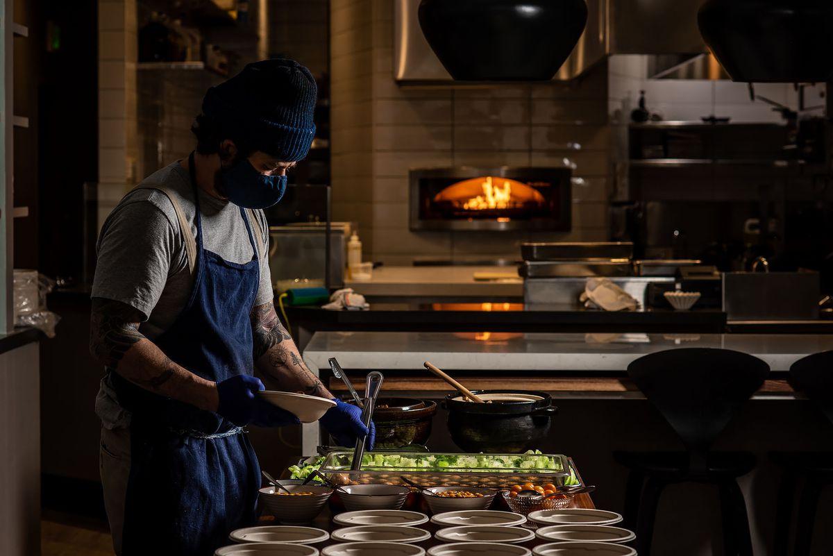 Josef Centeno prepares meals for first responders.