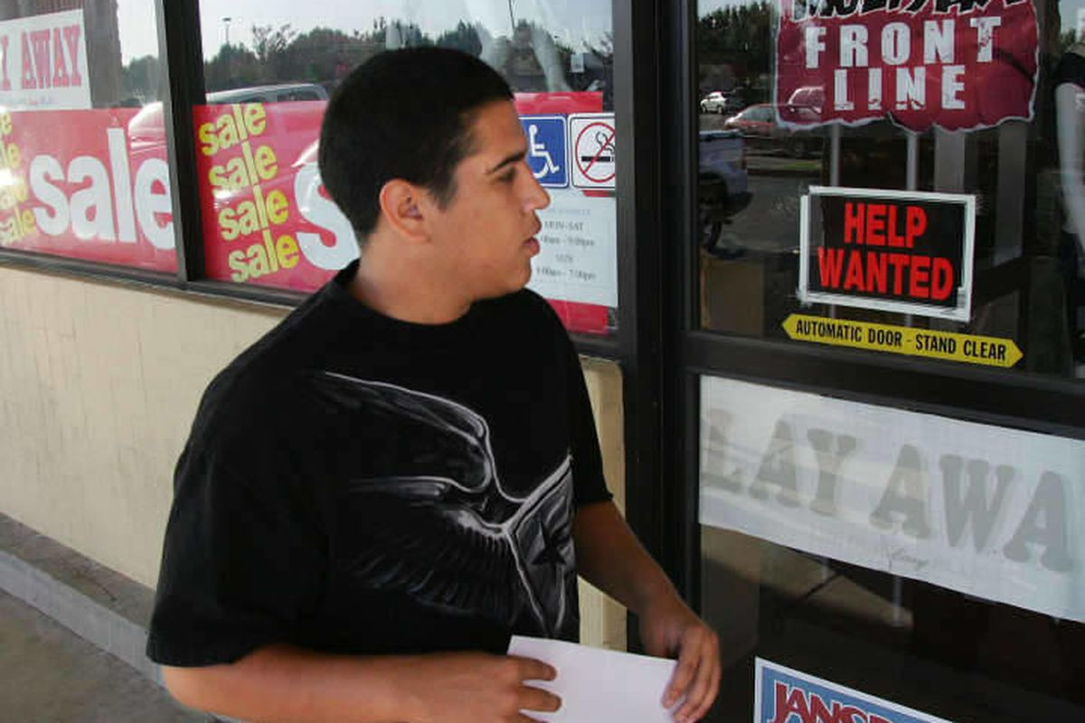 With a resume in hand, Cameron Hinojosa heads into the Family Clothes store looking for work Tuesday, Sep. 22, 2009 in Fresno, Calif.