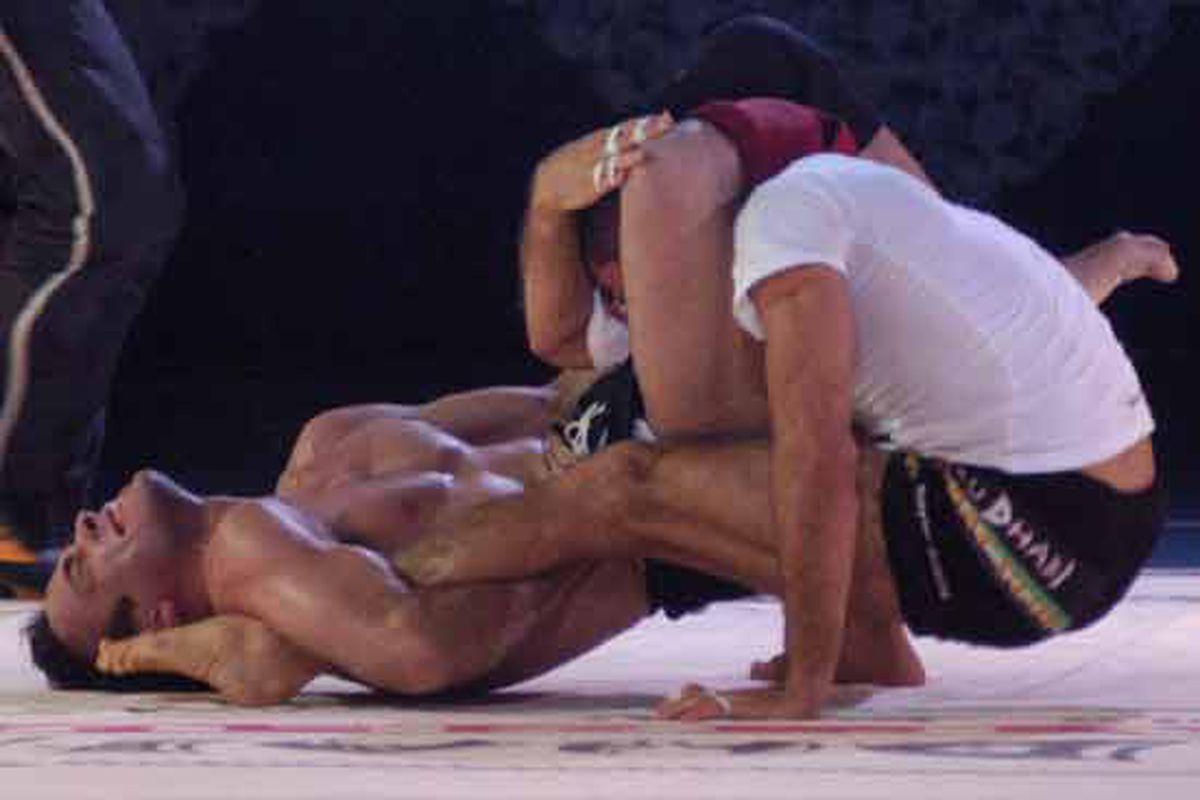 "Eddie Bravo's claim to fame, choking Royler Gracie for all he's worth at ADCC 2003 via <a href=""http://www.onzuka.com/Photos/Eddie%20Bravo%20triangling%20Royler%20Gracie.jpg"">www.onzuka.com</a>"