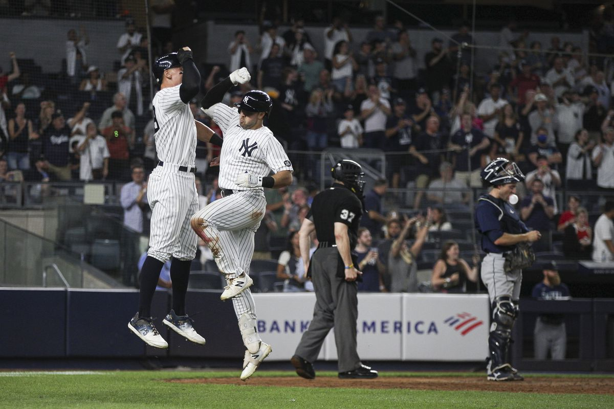 Giancarlo Stanton #27 celebrates with Joey Gallo #13 of the New York Yankees during the game between the Seattle Mariners and the New York Yankees at Yankee Stadium on Thursday, August 5, 2021 in New York, New York.