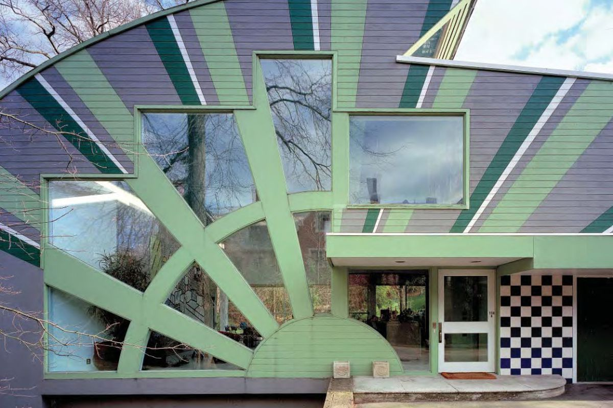 mint green front facade with rays and square windows
