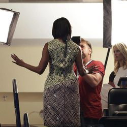 First Lady Michelle Obama gestures while being interviewed in a television studio before the Democratic National Convention in Charlotte, N.C., on Monday, Sept. 3, 2012.
