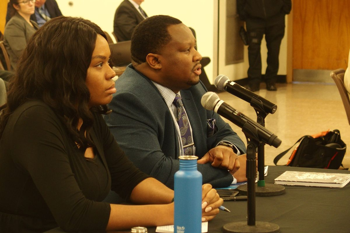 Tyree Daniels, board chair for Memphis College Preparatory, right, speaks to Shelby County Schools board members during a hearing on the school's contract renewal.