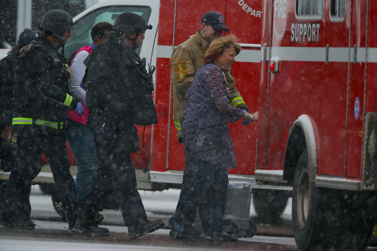 Hostages are escorted to an ambulance during an active shooter situation outside a Planned Parenthood facility in Colorado Springs.