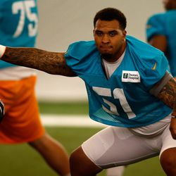 Jul 21, 2013; Davie, FL, USA;  Miami Dolphins center Mike Pouncey (51) during training camp at the Doctors Hospital Training Facility at Nova Southeastern University.