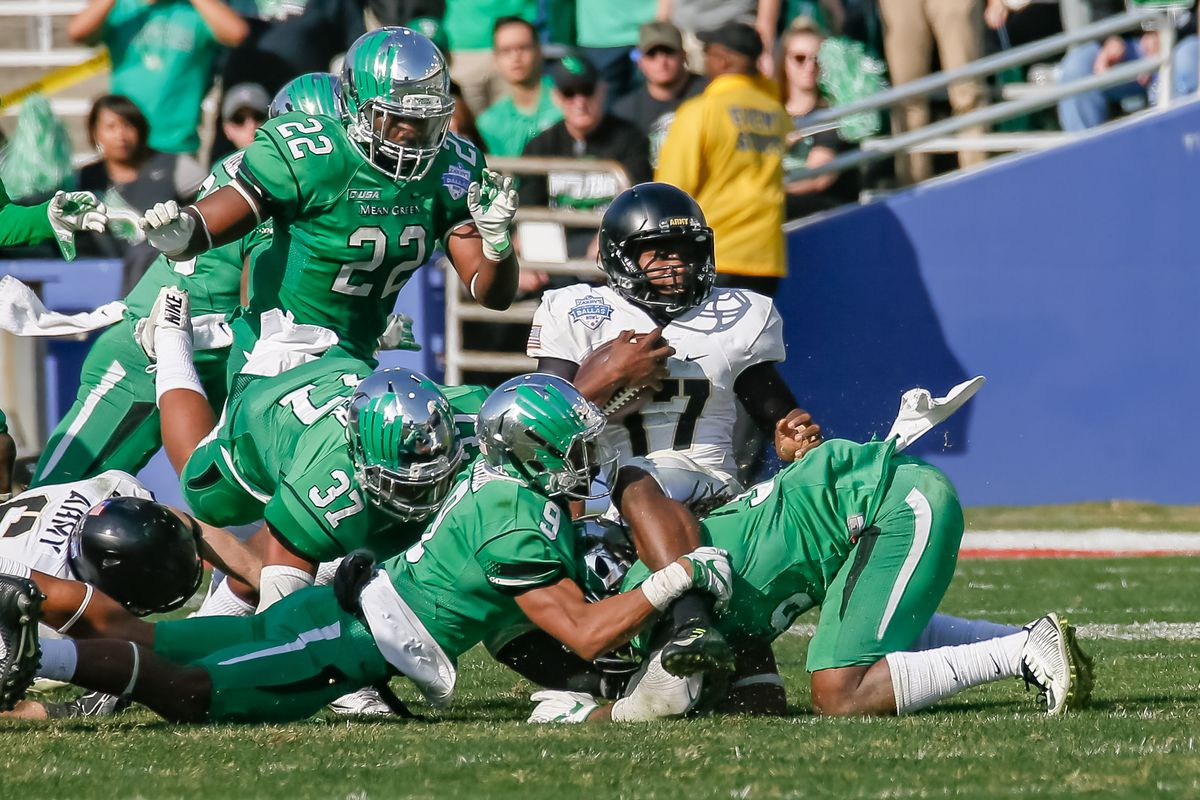 Army Black Knights quarterback Ahmad Bradshaw (17) is tackled for a loss during the Zaxby's Heart of Dallas Bowl between the Army West Point Black Knights and the North Texas Mean Green on December 27, 2016, at the Cotton Bowl in Dallas, TX. Army defeats North Texas 38-31 in overtime.