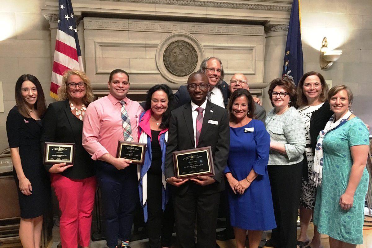 Bronx International High School teacher Alhassan Susso, center, is New York State's 2019 Teacher of the Year.