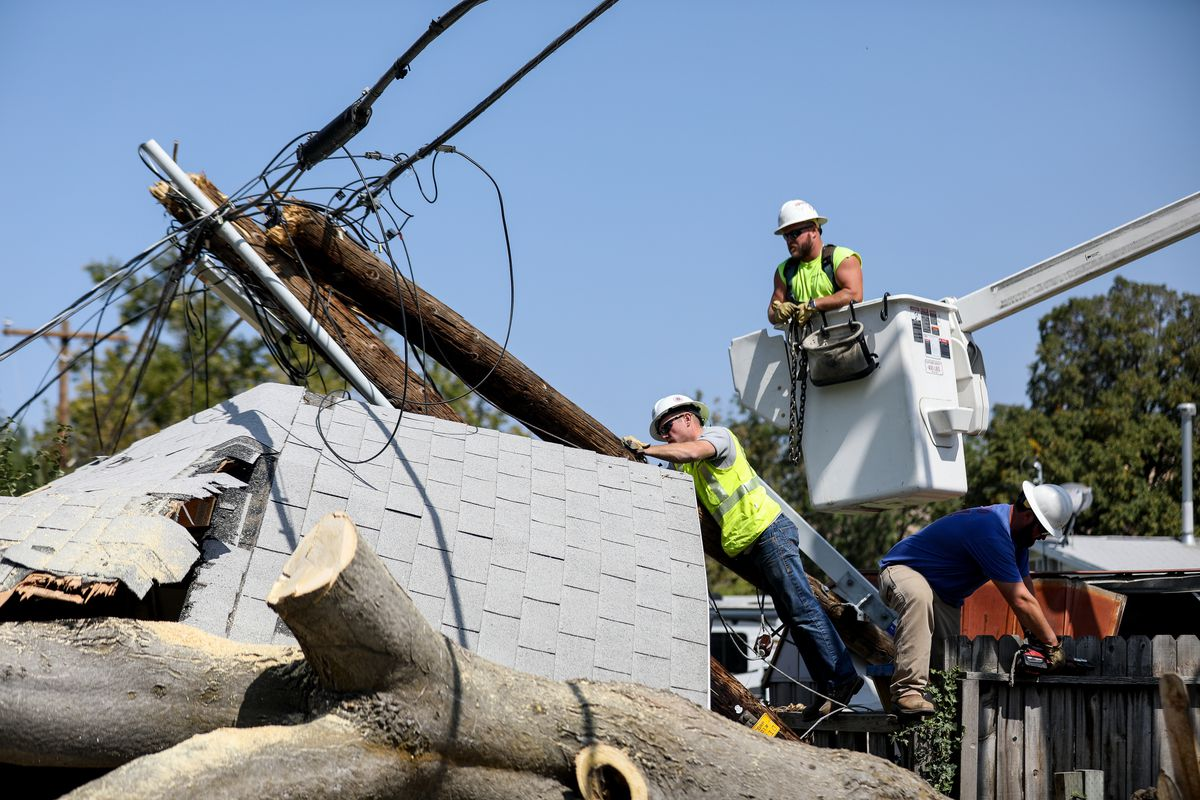 A crew from MidAmerican Energy, a power company based in Iowa, help restore power in the Rose Park neighborhood of Salt Lake City on Thursday, Sept. 10, 2020. Residents and utility companies are continuing to clean up after severe winds hit the Wasatch Front on Tuesday and Wednesday, leaving hundreds of thousands without power.