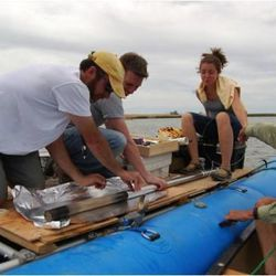 Scientists extract a sediment core from Spring Lake, UT as part of a study that found a link between climate change and wildfire.