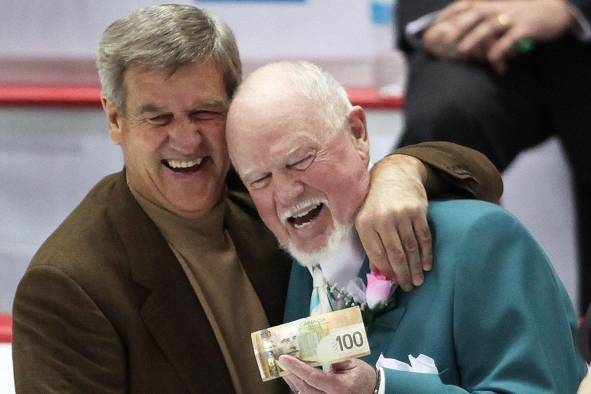 Bobby Orr hugs it out with Don Cherry