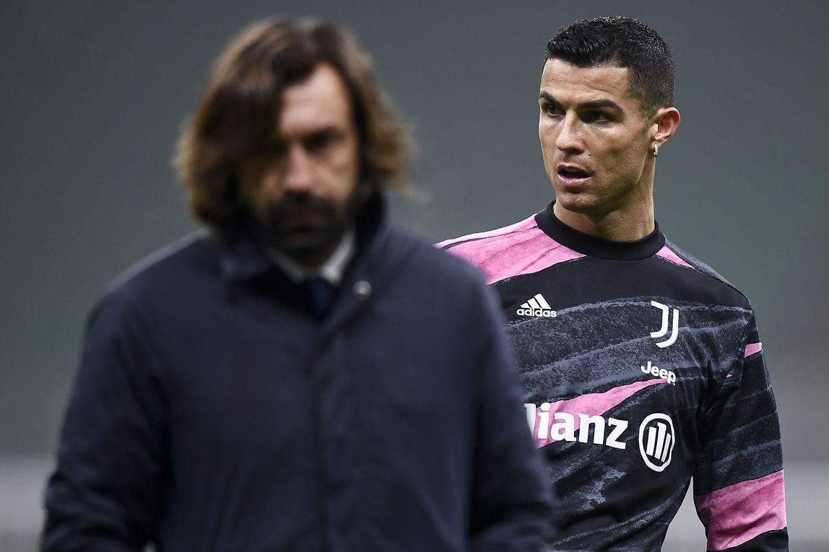 Cristiano Ronaldo (R) of Juventus FC and Andrea Pirlo, head...