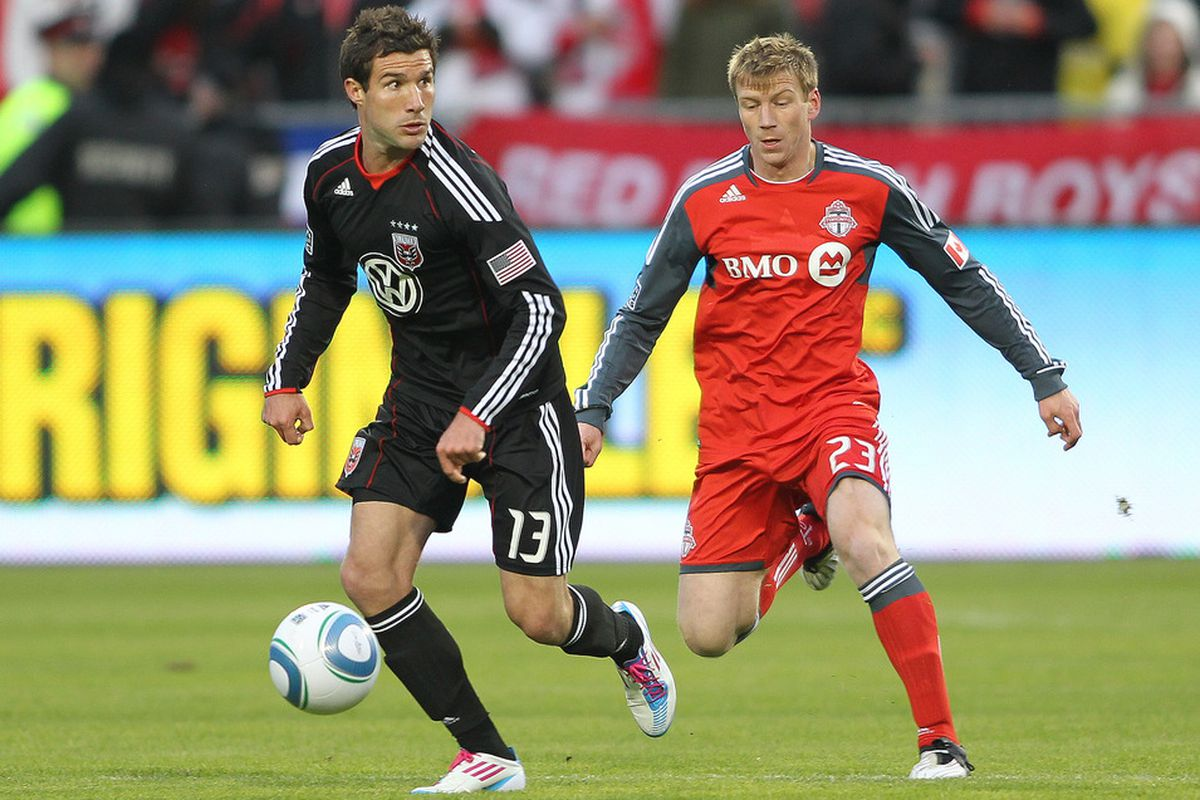 TORONTO, CANADA - APRIL 16:  Jacob Peterson #23 of the Toronto FC chases after Chris Pontius #13 of D.C. United in a game on April 16, 2011 at BMO Field in Toronto, Canada. D.C. United defeated Toronto FC 3-0. (Photo by Claus Andersen/Getty Images)