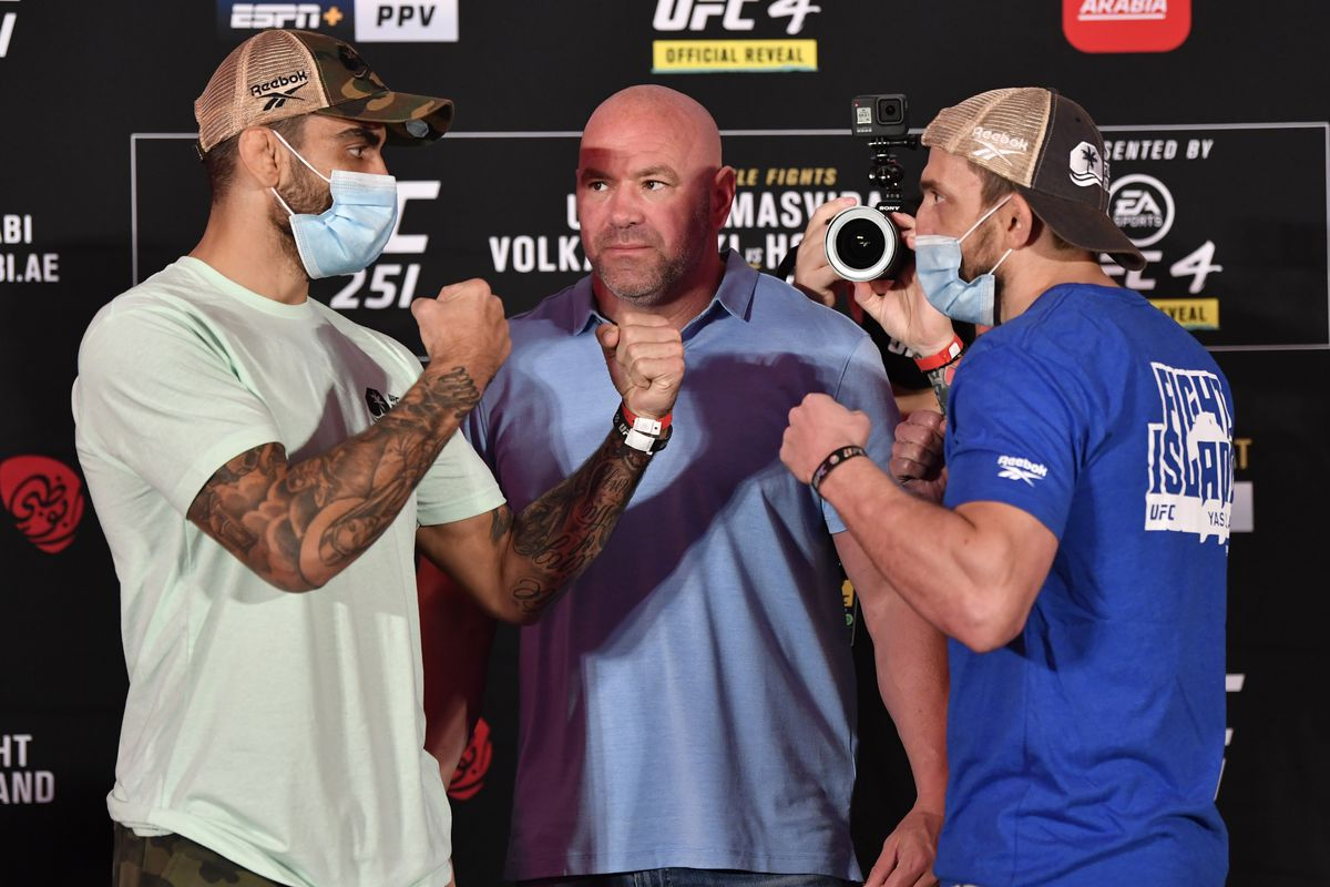 Opponents Elizeu Zaleski dos Santos of Brazil and Muslim Salikhov of Russia face off during the UFC 251 official weigh-in inside Flash Forum at UFC Fight Island on July 10, 2020 on Yas Island Abu Dhabi, United Arab Emirates.