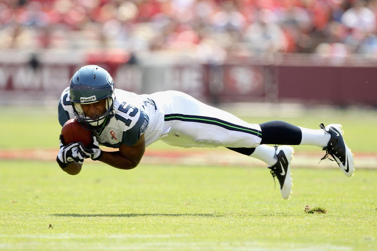 Doug Baldwin makes one of his four catches against former head coach Jim Harbaugh and the 49ers on Sunday.