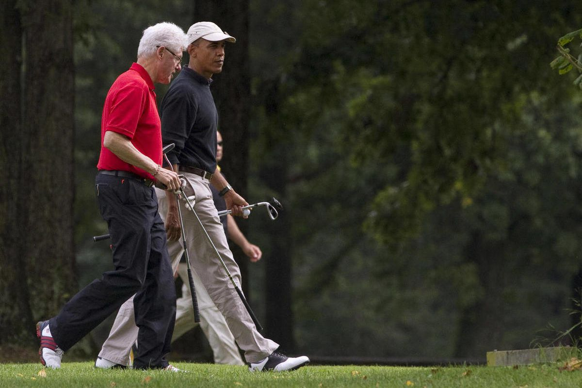 FILE - In this Sept. 24, 2011, file photo President Barack Obama, right, and former President Bill Clinton talk during a game of golf at Andrews Air Force Base, Md. Once a tense rivalry, the relationship between Obama and Clinton has evolved into a genuin