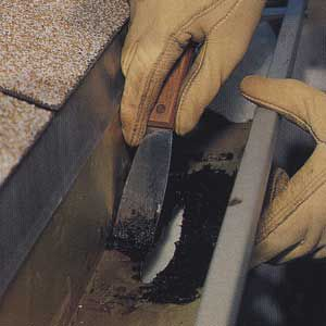 <p>Apply a liberal amount of roofing cement around the hole with a caulking gun. Spread the cement a few inches beyond the hole on all sides.</p>