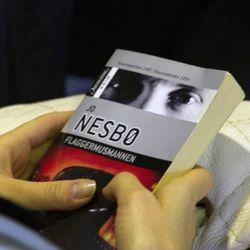 A model holds Norwegian writer Jo Nesbo's Flaggermusmannen