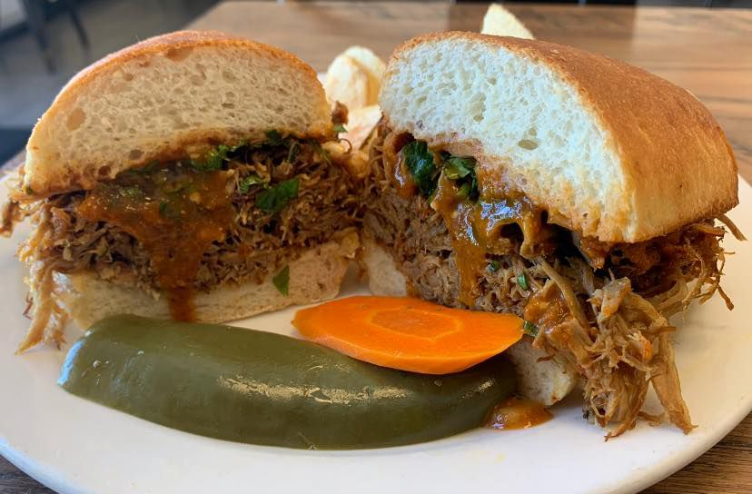 A torta with a pepper and carrot slice on a plate