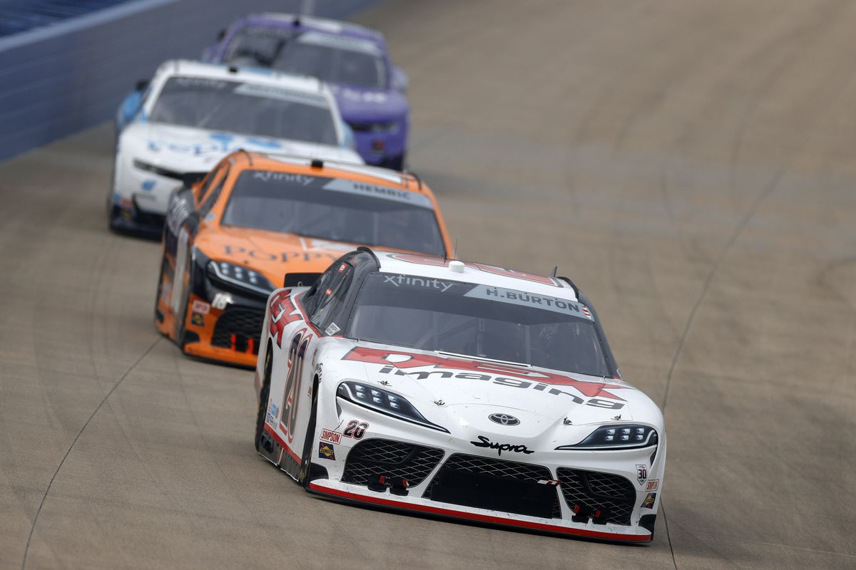 Harrison Burton, driver of the #20 DEX Imaging Toyota, leads the field during the NASCAR Xfinity Series Tennessee Lottery 250 at Nashville Superspeedway on June 19, 2021 in Lebanon, Tennessee.