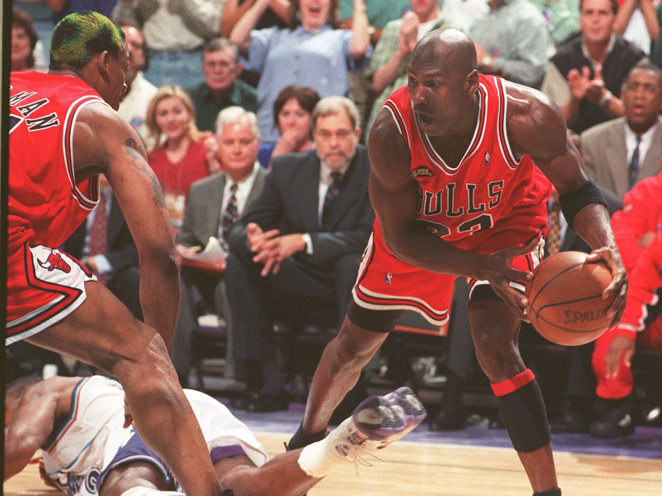 Micheal Jordan after stealing the ball in the final seconds during Sunday night's Game 6 of the NBA Finals at the Delta Center, June 14, 1998.