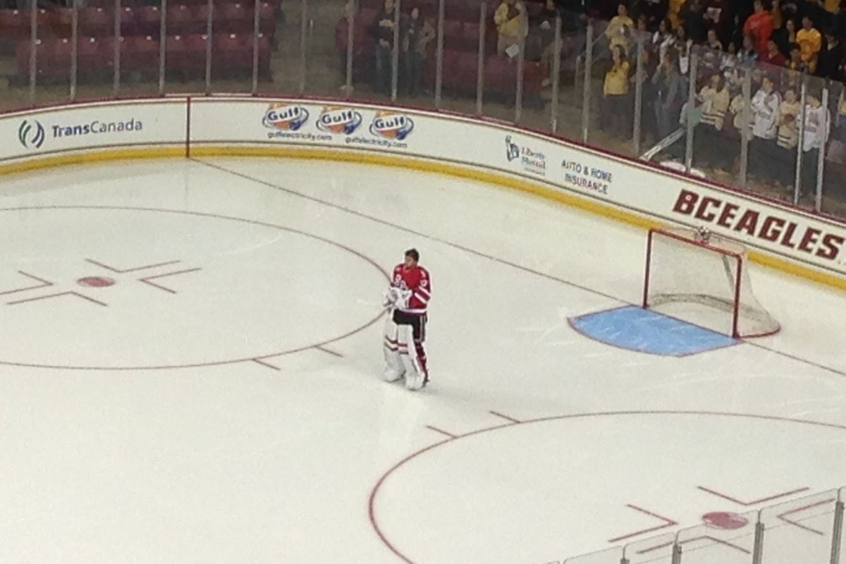 RPI goaltender Jason Kasdorf stands for the national anthem prior to the Engineers' game at Boston College.