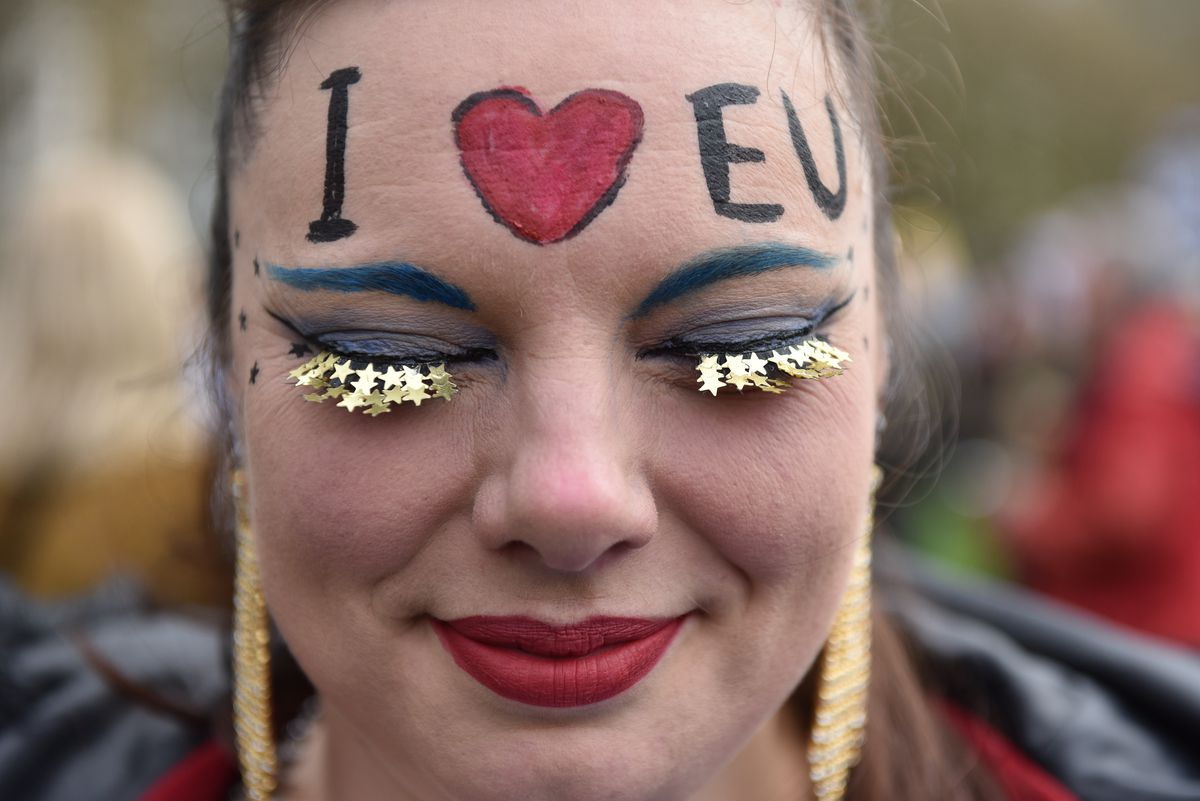 "A protester with ""I [heart] EU"" painted on her face takes part in the People's Vote anti-Brexit march in London on March 23, 2019."