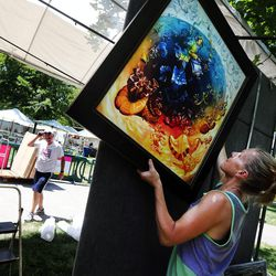 Laura Junge and Chris Jackson from Jackson/Junge Gallery from Chicago get their booth set up as artists prepare for the Utah Arts Festival in Salt Lake City on Wednesday, June 21, 2017.