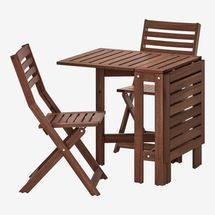 A wooden square top folding table and 2 chairs
